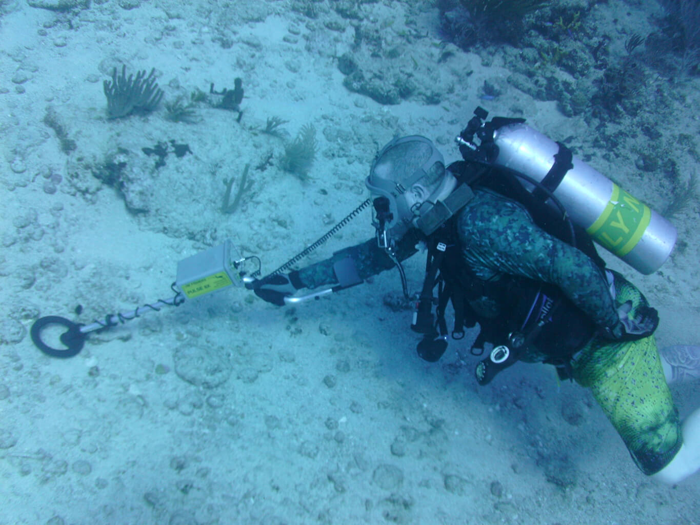 A diver under water using the Pulse 8X